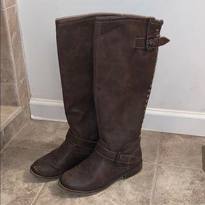 Dark brown boots with orange accent zipper